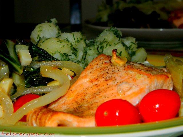 salmon with cherry tomatoes and potatoe salad.jpg